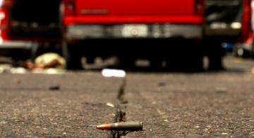 Proyectil de una arma de fuego en una calle